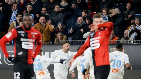 <p>               Marseille's Kevin Strootman, center, celebrates with teammates after scoring his side's opening goal during the League One soccer match between Rennes and Marseille, at the Roazhon Park stadium in Rennes, France, Friday, Jan. 10, 2020. (AP Photo/David Vincent)             </p>