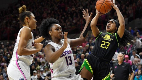 <p>               Oregon's Minyon Moore, right, shoots as Connecticut's Olivia Nelson-Ododa, left, and Christyn Williams, center, defend in the second half of an NCAA college basketball game, Monday, Feb. 3, 2020, in Storrs, Conn. (AP Photo/Jessica Hill)             </p>