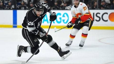 <p>               Los Angeles Kings right wing Marin Frk, left, shoots the puck as Calgary Flames center Elias Lindholm watches during the second period of an NHL hockey game Wednesday, Feb. 12, 2020, in Los Angeles. (AP Photo/Mark J. Terrill)             </p>