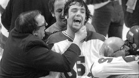 """<p>               *ATTENTION AP SPORTS PHOTO DESK, EMBARGOED UNTIL 12:01AM ON FRIDAY, DECEMBER 21, 2020* In this Feb. 22, 1980, photo, Team USA goaltender Jim Craig got a hug from goalie coach Warren Strelow in the moments after defeating the Soviet Union during the medal-round of the Winter Olympics in Lake Placid, N.Y. Tourism is a $1.2 billion industry in the Lake Placid region, much of it still fueled by the memory of the U.S. hockey team beating the Soviet Union as the """"Miracle on Ice"""" highlight of the 1980 Olympic Games. (Tom Sweeney/Star Tribune via AP)             </p>"""