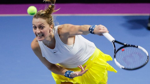 <p>               Petra Kvitova of Czech Republic returns the ball to Alison van Uytvanck of Belgium during the St. Petersburg Ladies Trophy-2020 tennis tournament match in St.Petersburg, Russia, Thursday, Feb. 13, 2020. (AP Photo/Dmitri Lovetsky)             </p>