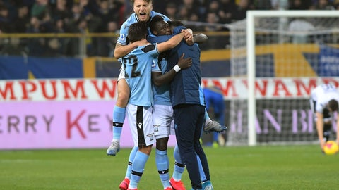 <p>               Lazio's Felipe Caicedo, center, celebrates with Ciro Immobile, top, and other teammates after scoring his side's first goal during the Italian Serie A soccer match between Parma and Lazio at the Tardini stadium in Parma, Italy, Sunday, Feb. 9, 2020 (Claudio Grassi/LaPresse via AP)             </p>