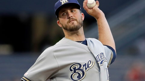 <p>               FILE - In this Aug. 7, 2019, file photo, Milwaukee Brewers starting pitcher Drew Pomeranz delivers during the first inning of the team's baseball game against the Pittsburgh Pirates in Pittsburgh. Pomeranz moved to the San Diego Padres for the 2020 season. (AP Photo/Gene J. Puskar, File)             </p>