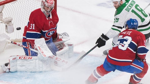 <p>               Dallas Stars' Jason Dickinson (18) moves in on Montreal Canadiens goaltender Carey Price as Canadiens' Victor Mete (53) defends during the second period of an NHL hockey game Saturday, Feb. 15, 2020, in Montreal. (Graham Hughes/The Canadian Press via AP)             </p>