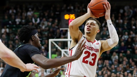 <p>               Wisconsin guard Kobe King (23) shoots over the defense of Michigan State forward Gabe Brown during the first half of an NCAA college basketball game, Friday, Jan. 17, 2020, in East Lansing, Mich. (AP Photo/Carlos Osorio)             </p>