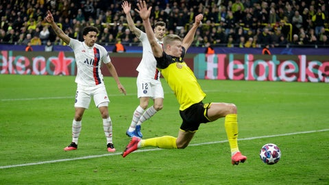 <p>               Dortmund's Erling Braut Haaland, front, scores his side's opening goal during the Champions League round of 16 first leg soccer match between Borussia Dortmund and Paris Saint Germain in Dortmund, Germany, Tuesday, Feb. 18, 2020. (AP Photo/Michael Probst)             </p>