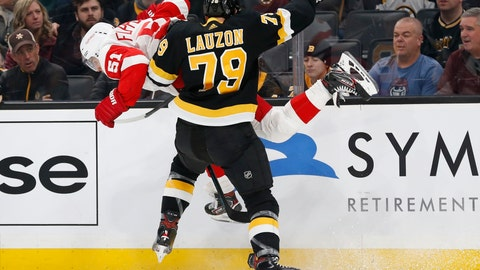 <p>               Boston Bruins' Jeremy Lauzon (79) checks Detroit Red Wings' Valtteri Filppula (51) during the first period of an NHL hockey game in Boston, Saturday, Feb. 15, 2020. (AP Photo/Michael Dwyer)             </p>