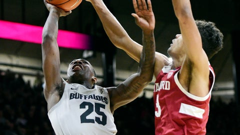 <p>               Colorado's McKinley Wright IV has his shot blocked by Stanford's Oscar Da Silva during the first half of an NCAA college basketball game Saturday, Feb. 8, 2020, in Boulder, Colo. (AP Photo/Cliff Grassmick)             </p>