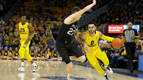 <p>               Marquette's Markus Howard (0) drives to the basket against Butler's Sean McDermott (22) during the first half of an NCAA college basketball game Sunday, Feb. 9, 2020, in Milwaukee. (AP Photo/Aaron Gash)             </p>