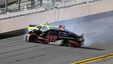 <p>               Daniel Suarez (96) and Ryan Blaney wreck as they come out of Turn 4 during the first of two NASCAR Daytona 500 qualifying auto races at Daytona International Speedway, Thursday, Feb. 13, 2020, in Daytona Beach, Fla. (AP Photo/David Graham)             </p>