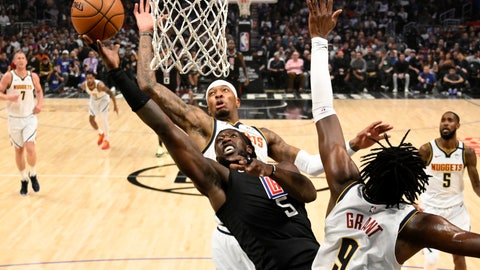 <p>               Los Angeles Clippers forward Montrezl Harrell, left, shoots as Denver Nuggets forward Torrey Craig, center, and forward Jerami Grant defend during the first half of an NBA basketball game Friday, Feb. 28, 2020, in Los Angeles. (AP Photo/Mark J. Terrill)             </p>