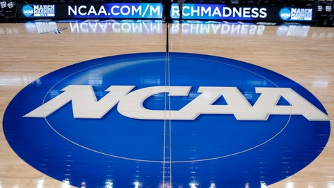 <p>               FILE - In this March 18, 2015, file photo, the NCAA logo is displayed at center court as work continues at The Consol Energy Center in Pittsburgh, for the NCAA college basketball tournament. The NCAA took a significant step toward allowing all Division I athletes to transfer one time without sitting out a season of competition. A plan to change the waiver process is expected to be presented to the Division I Council in April, 2020. If adopted, new criteria would go into effect for the 2020-21 academic year and be a boon for athletes in high-profile sports such as football and men's and women's basketball. (AP Photo/Keith Srakocic, File)             </p>