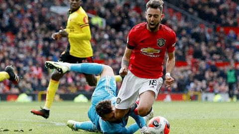<p>               Manchester United's Bruno Fernandes is brought down in the penalty area by Watford goalkeeper Ben Foster, during their English Premier League soccer match at Old Trafford in Manchester, England, Sunday Feb. 23, 2020. Fernandes went on to score from the penalty spot. (Martin Rickett/PA via AP)             </p>
