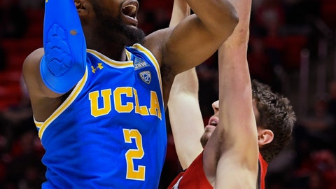 <p>               UCLA forward Cody Riley (2) looks to shoot over Utah forward Riley Battin during the first half of an NCAA college basketball game Thursday, Feb. 20, 2020, in Salt Lake City. (AP Photo/Alex Goodlett)             </p>