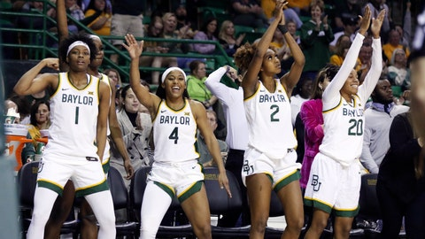 <p>               Baylor forward NaLyssa Smith, left, Te'a Cooper, DiDi Richards and Juicy Landrum celebrate at the end the second half of an NCAA college basketball game against Kansas State, Saturday, Feb. 29, 2020, in Waco, Texas. (AP Photo/Rod Aydelotte)             </p>