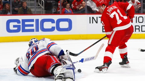 <p>               New York Rangers goaltender Henrik Lundqvist (30) stops a Detroit Red Wings center Dylan Larkin (71) shot in the second period of an NHL hockey game Saturday, Feb. 1, 2020, in Detroit. (AP Photo/Paul Sancya)             </p>