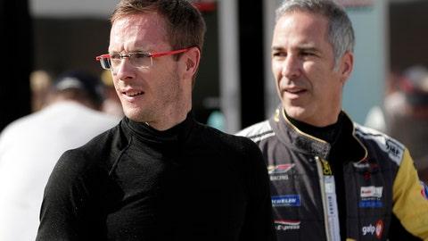 <p>               FILE - In this Friday, Jan. 3, 2020, file photo, Sebastien Bourdais, left, and Joao Barbosa walk back to their garage after a practice session during testing for the upcoming Rolex 24 hour auto race at Daytona International Speedway in Daytona Beach, Fla. Bourdais spent a day in early November helping IndyCar fine-tune its newest safety innovation. Later that night, he learned he was likely losing his job with a year remaining on his contract. (AP Photo/John Raoux, File)             </p>