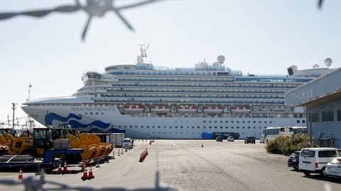 <p>               The quarantined ship Diamond Princess is pictured through barbed wire at Yokohama port in Yokohama, near Tokyo Monday, Feb. 17, 2020. Japanese officials have confirmed 99 more people infected by the new virus aboard the ship, the Health Ministry said Monday. (Mayuko Isobe/Kyodo News via AP)             </p>
