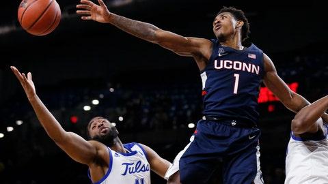 <p>               Connecticut guard Christian Vital (1) and Tulsa forward Jeriah Horne (41) reach for the ball during the second half of an NCAA college basketball game in Tulsa, Okla., Thursday, Feb. 6, 2020. (AP Photo/Sue Ogrocki)             </p>