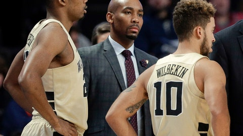 <p>               This Nov. 28, 2017 file photo shows former Wake Forest assistant coach Jamill Jones, center, during the second half of an NCAA college basketball game in Winston-Salem, N.C. A jury in Queens criminal court found Jones guilty of misdemeanor assault, on Thursday, for the punch that killed 35-year-old Sandor Szabo in August 2018.(AP Photo/Chuck Burton)             </p>