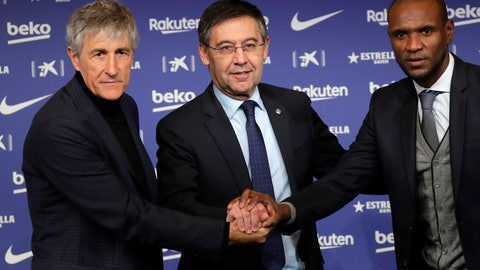 <p>               Soccer coach Quique Setien poses with FC Barcelona's President Josep Maria Bartomeu, center, and director of football Eric Abidal, right, while being officially introduced as the club's new coach at the Camp Nou stadium in Barcelona, Spain, Tuesday, Jan. 14, 2020. Barcelona made a rare coaching change midway through the season, replacing Ernesto Valverde with former Real Betis manager Quique Setien on Monday. (AP Photo/Emilio Morenatti)             </p>