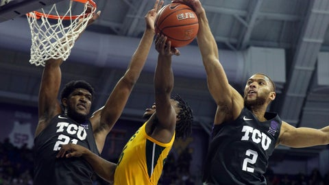 <p>               TCU center Kevin Samuel (21) and guard Edric Dennis (2) defend against a shot by Baylor guard Davion Mitchell (45) during the second half of an NCAA college basketball game on Saturday, Feb. 29, 2020 in Fort Worth, Texas. (AP Photo/Richard W. Rodriguez)             </p>