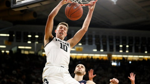 <p>               Iowa guard Joe Wieskamp (10) dunks the ball over Illinois forward Giorgi Bezhanishvili during the second half of an NCAA college basketball game, Sunday, Feb. 2, 2020, in Iowa City, Iowa. (AP Photo/Charlie Neibergall)             </p>
