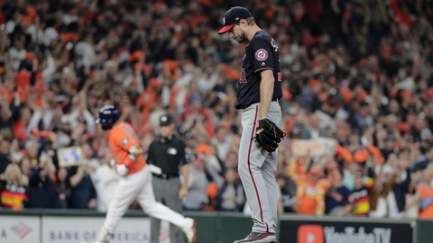 <p>               FILE - In this Oct. 30, 2019, file photo, Houston Astros' Yuli Gurriel hits a home run off Washington Nationals starting pitcher Max Scherzer during the second inning of Game 7 of the baseball World Series in Houston. The last time these teams played the Nationals were celebrating their World Series title in Houston. Since then the Astros have become the league's villains, with a sign-stealing scandal tarnishing their reputation and casting a shadow on their 2017 title. (AP Photo/David J. Phillip, File)             </p>