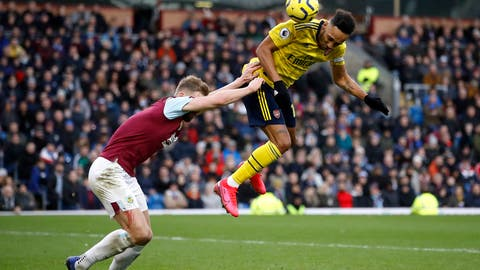<p>               Arsenal's Pierre-Emerick Aubameyang, right, and Burnley's Ben Mee battle for the ball during the English Premier League soccer match at Turf Moor, Burnley, England, Sunday Feb. 2, 2020. (Martin Rickett/PA via AP)             </p>