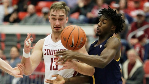 <p>               Washington State forward Jeff Pollard, left, and California guard Joel Brown go after the ball during the second half of an NCAA college basketball game in Pullman, Wash., Wednesday, Feb. 19, 2020. California won 66-57. (AP Photo/Young Kwak)             </p>