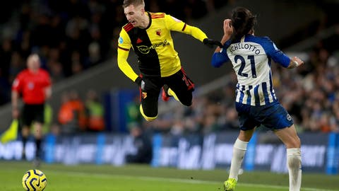 <p>               Watford's Gerard Deulofeu takes a tumble after a challenge from Brighton and Hove Albion's Ezequiel Schelotto, right, during the English Premier League soccer match at the AMEX Stadium, Brighton, England, Saturday Feb. 8, 2020. (Adam Davy/PA via AP)             </p>