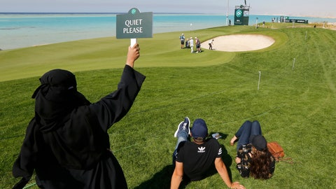 "<p>               A Saudi woman wearing Islamic ""Niqab"" raises ""quiet please"" sign as British Ashley Chesters plays out of a bunker at the 16th hole during the final round of the Saudi International at Royal Greens Golf and Country Club, Sunday, Feb. 2, 2020, in Red Sea resort of King Abdullah Economic City, Saudi Arabia. (AP Photo/Amr Nabil)             </p>"