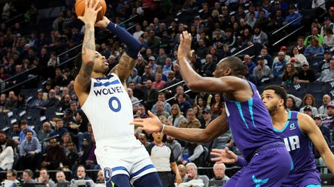 <p>               Charlotte Hornets' P.J. Washington Jr., right, pressures Minnesota Timberwolves' James Johnson into passing the ball during the first half of an NBA basketball game Wednesday, Feb. 12, 2020, in Minneapolis. (AP Photo/Jim Mone)             </p>