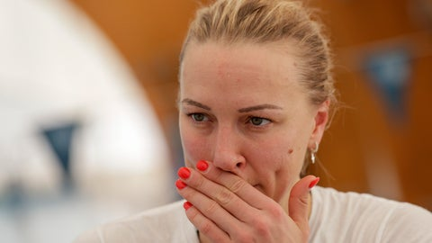 <p>               Swedish swimmer Sarah Sjöström listens to questions during an interview with The Associated Press, in Naples, Wednesday, Feb. 26, 2020. If any thoughts were creeping into their minds that the Tokyo Olympics might be canceled due to a viral outbreak, elite swimmers Katinka Hosszú, Chad le Clos and Sarah Sjöström certainly didn't show it during a strenuous two-hour training session Wednesday.(AP Photo/Andrew Medichini)             </p>