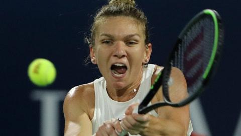 <p>               Romania's Simona Halep returns the ball to Belarusian Aryna Sabalenka during a match of the Dubai Duty Free Tennis Championship in Dubai, United Arab Emirates, Thursday, Feb. 20, 2020. (AP Photo/Kamran Jebreili)             </p>