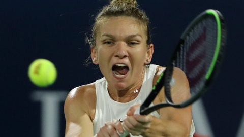 <p>               Romania's Simona Halep returns the ball to Belarusian Aryna Sabalenka during a match of the Dubai Duty Free Tennis Championship in Dubai, United Arab Emirates, Thursday, Feb. 20, 2020. (AP Photo/Kamran Jebreili)             </p>