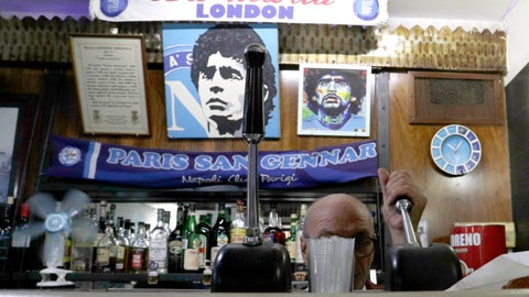 <p>               A bar tender prepares an espresso coffee inside the Bar Nilo where a makeshift shrine of soccer legend and former Napoli player Diego Armando Maradona is displayed, in downtown Naples, Italy, Wednesday, Sept. 18, 2019. Maradona achieved some of his most memorable exploits and in Naples is still revered with god-like status. (AP Photo/Gregorio Borgia)             </p>