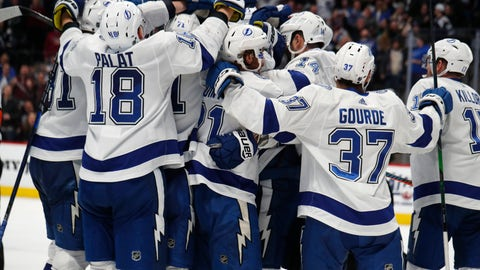 <p>               Tampa Bay Lightning right wing Nikita Kucherov is mobbed by teammates after scoring the winning goal in overtime of an NHL hockey game against the Colorado Avalanche Monday, Feb. 17, 2020, in Denver. The Lightning won 4-3. (AP Photo/David Zalubowski)             </p>