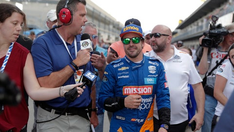 <p>               FILE - In this May 18, 2019, file photo, Fernando Alonso, of Spain, is interviewed as he walked from the pit area after qualifications ended for the Indianapolis 500 IndyCar auto race at Indianapolis Motor Speedway in Indianapolis. Alonso will once again attempt to complete motorsports' version of the Triple Crown with a return to the Indianapolis 500 in May with McLaren.(AP Photo/Michael Conroy, File)             </p>