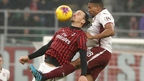 <p>               AC Milan's Zlatan Ibrahimovic, left, challenges for the ball with Torino's Bremer during the Serie A soccer match between AC Milan and Torino at the San Siro stadium, in Milan, Italy, Monday, Feb. 17, 2020. (AP Photo/Antonio Calanni)             </p>