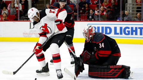 <p>               New Jersey Devils' Wayne Simmonds (17) tries to control the puck in front of Carolina Hurricanes goaltender Petr Mrazek (34), of the Czech Republic, during the third period of an NHL hockey game in Raleigh, N.C., Friday, Feb. 14, 2020. (AP Photo/Karl B DeBlaker)             </p>