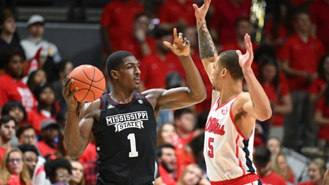 <p>               Mississippi State forward Reggie Perry (1) looks for room past Mississippi forward KJ Buffen (5) during the second half of an NCAA college basketball game in Oxford, Miss., Tuesday, Feb. 11, 2020. Mississippi won 83-58. (AP Photo/Thomas Graning)             </p>
