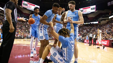 <p>               North Carolina guard Cole Anthony (2) is picked up by his teammates after Florida State was penalized for charging in the second half of an NCAA college basketball game in Tallahassee, Fla., Monday, Feb. 3, 2020. Florida State defeated North Carolina 65-59. (AP Photo/Mark Wallheiser)             </p>