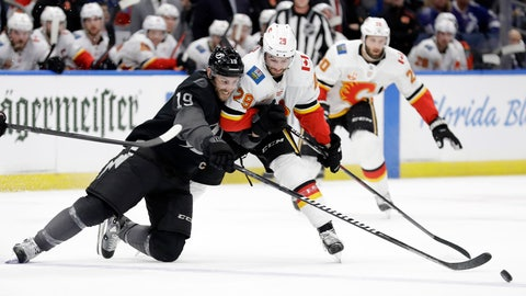 <p>               Tampa Bay Lightning center Barclay Goodrow (19) and Calgary Flames center Dillon Dube (29) battle for control of the puck during the second period of an NHL hockey game Saturday, Feb. 29, 2020, in Tampa, Fla. (AP Photo/Chris O'Meara)             </p>