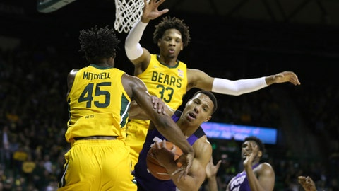 <p>               TCU guard Desmond Bane, right, grabs the arms of Baylor guard Davion Mitchell, left, while being pressured by forward Freddie Gillespie, in the first half of an NCAA college basketball game, Saturday, Feb. 1, 2020, in Waco, Texas. (AP Photo/Rod Aydelotte)             </p>