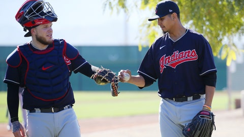 <p>               Cleveland Indians starting pitcher Carlos Carrasco, right, taps the glove of catcher Roberto Perez, left, after a pitching session during spring training baseball workouts for pitchers and catchers Thursday, Feb. 13, 2020, in Avondale, Ariz. (AP Photo/Ross D. Franklin)             </p>