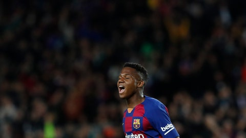 <p>               Barcelona's Ansu Fati celebrates after scoring his side's opening goal during a Spanish La Liga soccer match between Barcelona and Levante at the Camp Nou stadium in Barcelona, Spain, Sunday Feb. 2, 2020. (AP Photo/Joan Monfort)             </p>