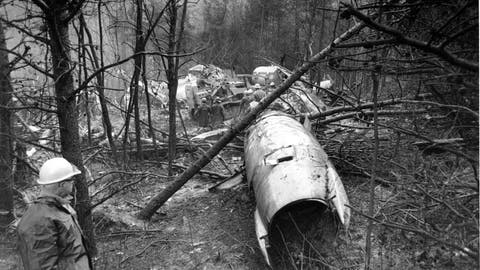 <p>               FILE - In this Nov. 15, 1970, file photo, a fireman looks over the wreckage of a DC-9 jet that was carrying 75 people including 26 members of the Marshall University football team, in Kenova, W.Va. Marshall and East Carolina will open the 2020 football season a week earlier to accommodate a national television broadcast to mark the 50th anniversary of the worst disaster in U.S. sports history.  (AP Photo/File)             </p>
