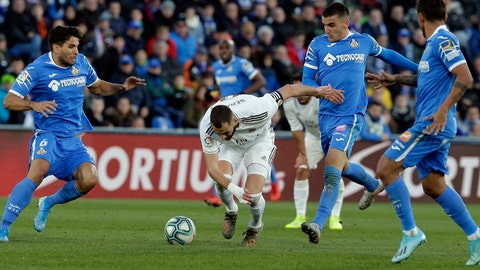 <p>               Real Madrid's Karim Benzema, center, falls during a Spanish La Liga soccer match between Getafe and Real Madrid at the Coliseum Alfonso Perez stadium in Getafe, Spain, Saturday, Jan. 4, 2020. (AP Photo/Paul White)             </p>