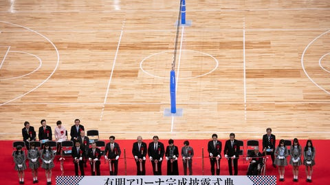 <p>               City officials and Olympic organizers pause for photos before cutting the ribbon during a grand opening ceremony of the Ariake Arena, a venue for volleyball at the Tokyo 2020 Olympics and wheelchair basketball during the Paralympic Games, Sunday, Feb. 2, 2020, in Tokyo. (AP Photo/Jae C. Hong)             </p>